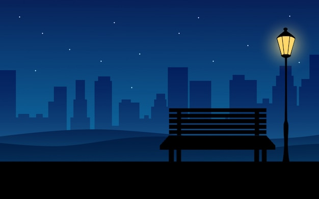 Night in city with bench in public park