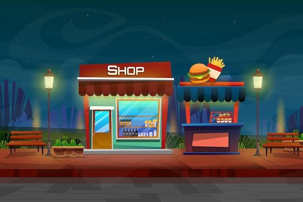 도시의 자연 공원에서 거리에 있는 음료 가게와 햄버거와 감자 튀김 가게의 야경