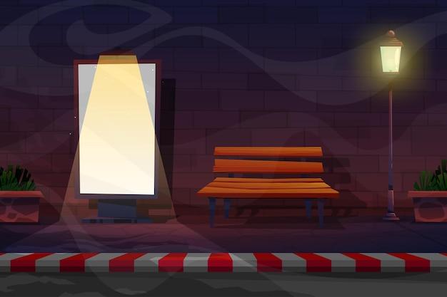 전화 부스가 있는 길가의 야경, spotlignt로 광고하는 간판