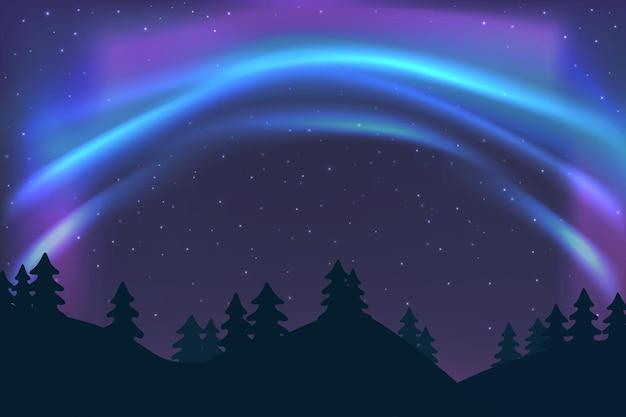 冬の青い北の光と星極光の光のトウヒの森の上のオーロラと夜空