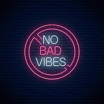 No bad vibes - glowing neon phrase in red warning circle. motivation quote in neon style. vector illustration.