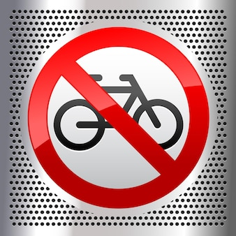 No bicycles symbol on a metallic perforated stainless steel sheet