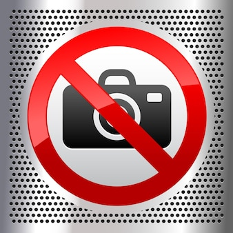 No photos symbol on a metallic perforated stainless steel sheet