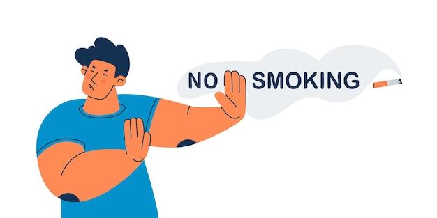금연 젊은 남자는 니코틴 거부를 홍보하는 제스처로 담배를 거부했습니다.