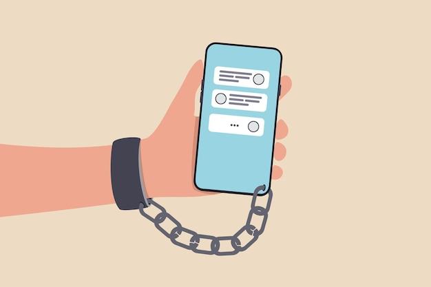 ノモフォビアまたは携帯電話恐怖症なし、スマートフォンおよびソーシャルメディア中毒または概念を見逃すことへの恐れ、チャットおよびソーシャルメディアアプリケーションを備えた携帯電話とチェーンされた手錠を持った若者。