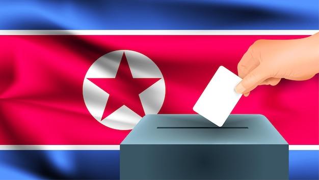 Флаг северной кореи, мужская рука голосование с фоном идеи концепции флага северной кореи