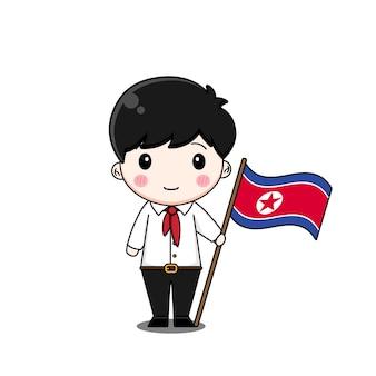플래그와 함께 국가 복장에있는 북한 소년