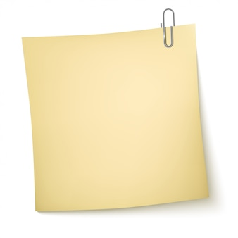 Note paper with paperclip on white