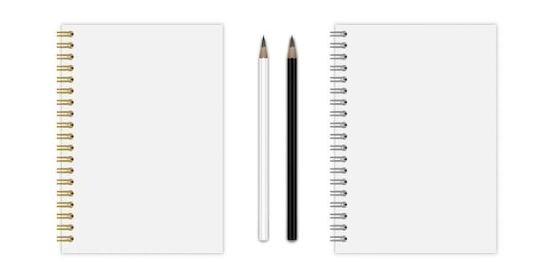 金と銀のスパイラル鉛筆でノート