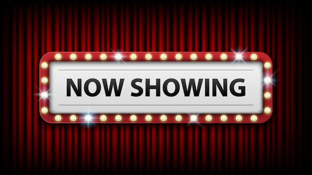 Now showing with electric bulbs frame on red curtain background