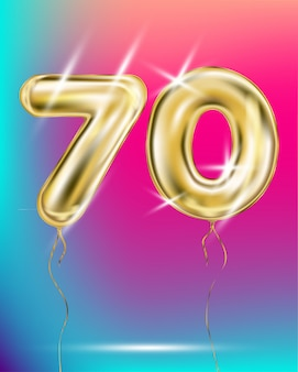 Number seventy gold foil balloon on gradient