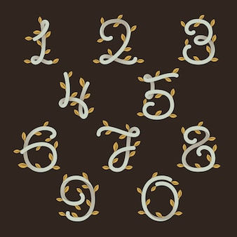 Numbers set logos with gold leaves.