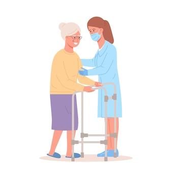 간호사는 워커와 함께 노인 환자를 돕습니다. 정형 외과 치료 재활 사람들