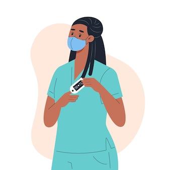 医療用マスクを着用している看護師は、指のパルスオキシメータで血中の酸素レベルを測定します
