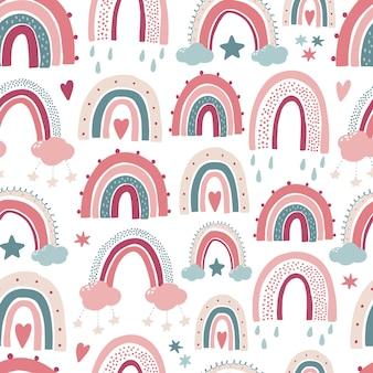 Nursery seamless pattern with rainbows and stars