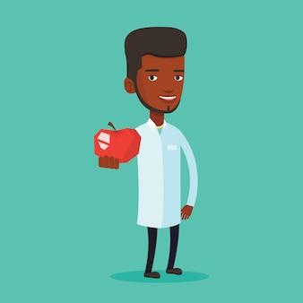新鮮な赤いリンゴを提供する栄養士。