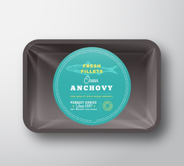 Ocean anchovy fillets. abstract fish plastic tray with cellophane cover packaging design round label or sticker. retro typography and hand drawn anchovy silhouette background layout. isolated.
