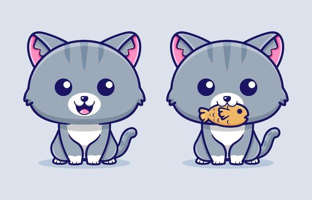 입에 물고기를 안고 앉아있는 고양이의 모습