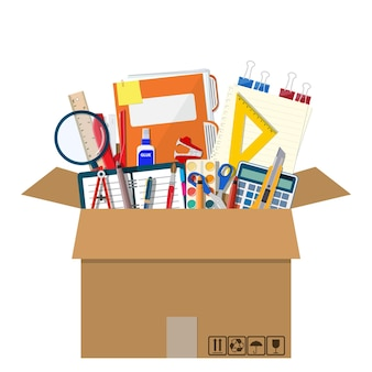 Office accessories in cardboard box.