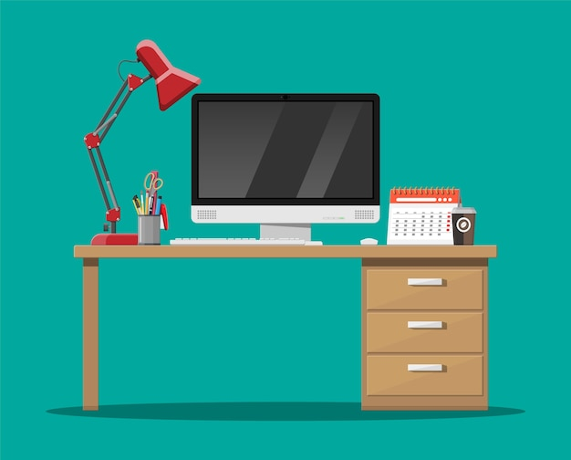 Office desk with computer, lamp, coffee cup, calendar and pen holder.