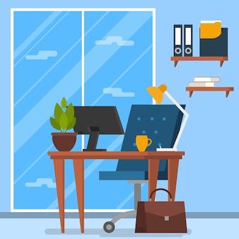 オフィスのインテリア。机の上の椅子とコンピューター