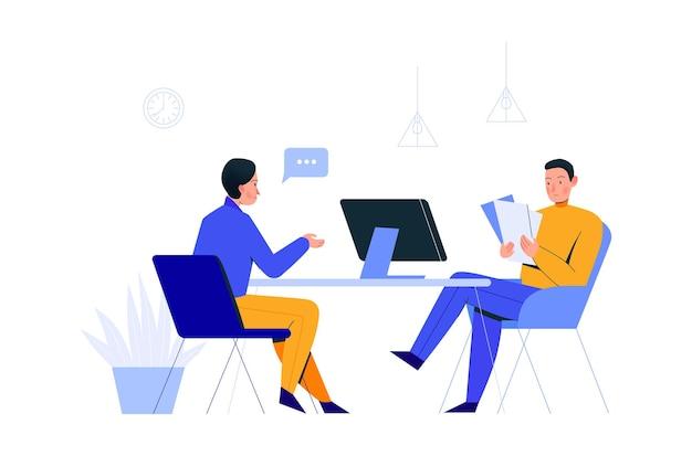 コンピューターと書類を持ってテーブルに座っている2人の同僚とのオフィスシーンの構成