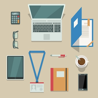 Office workplace with mobile devices and documents