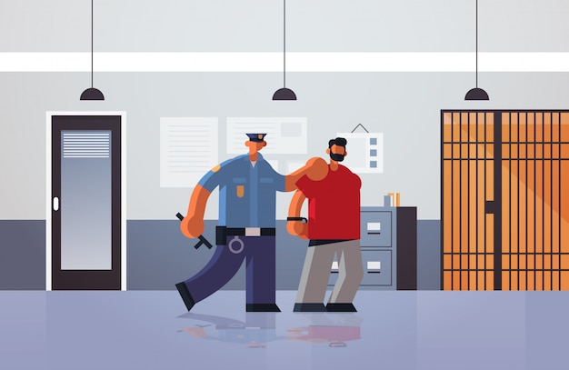 Officer arrested criminal policeman in uniform holding caught suspect thief security authority justice law service concept modern police department interior