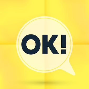 Ok speech bubble isolated on yellow note paper