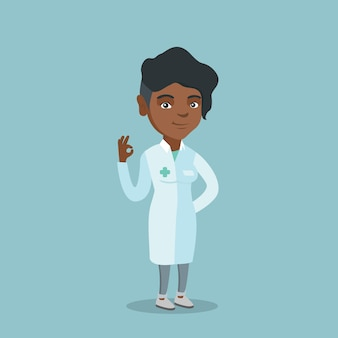 Okの標識を示す若いアフリカ系アメリカ人の医者。