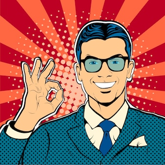 メガネの若い男が大丈夫なサインをしてok!