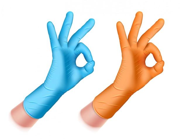 青、オレンジ色のゴム手袋で男の手。手はokの標識になります。はい