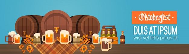 Oktoberfest beer festival banner wooden barrel with glass mugs decoration