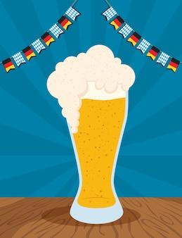 Oktoberfest party celebration with beer glass and garlands vector illustration design