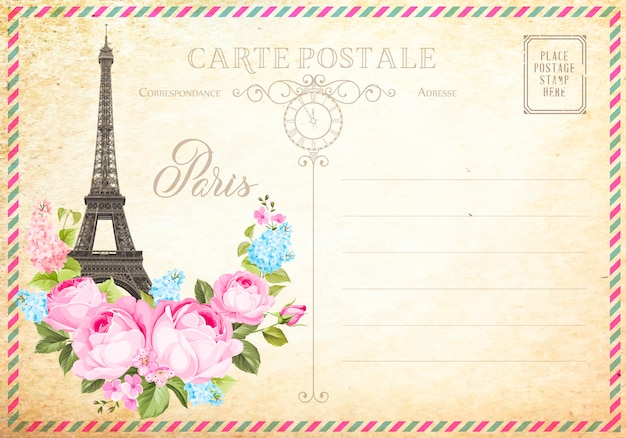 Old blank postcard with post stamps and eiffel tower with spring flowers on the top.