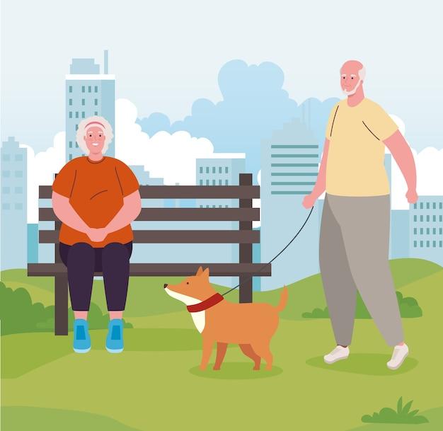 개 마스코트와 함께 야외 공원에서 오래 된 커플