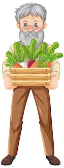 孤立した野菜の木枠を保持している老農家の男