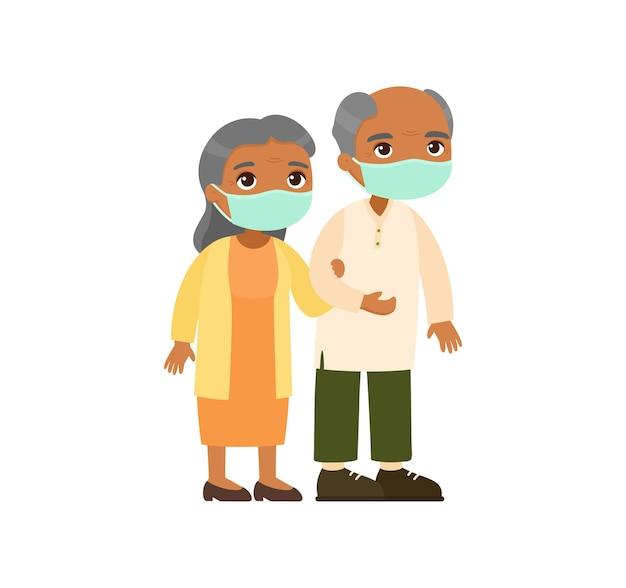 Vecchia coppia indiana in maschere mediche
