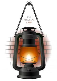 Old kerosene lamp on the brick wall fragment.