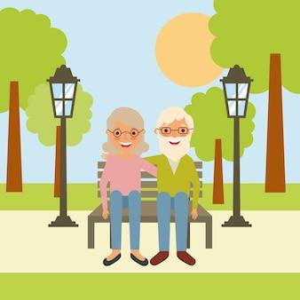 노인 할아버지와 할머니는 공원 벤치에 앉아