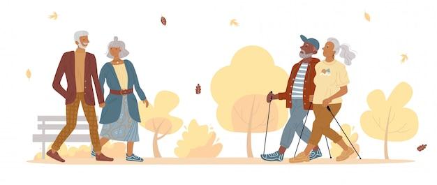 秋の公園を歩いて古い成熟した人々のカップル