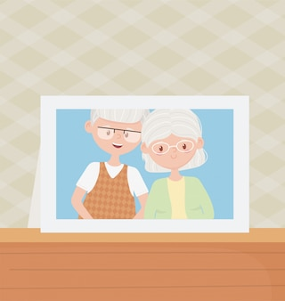 Old people, cute couple grandparents photo frame in table