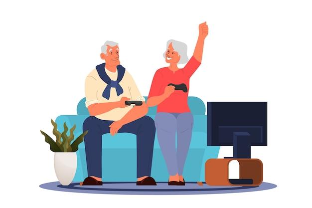 ビデオゲームをプレイする老人。コンソールコントローラーでビデオゲームをプレイする高齢者。高齢者のキャラクターは現代的なライフスタイルを持っています。