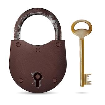 Старый ржавый замок и изношенный металлический ключ