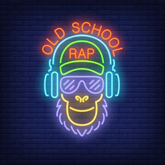 Old school rap neon text and cool monkey in glasses and headphones.