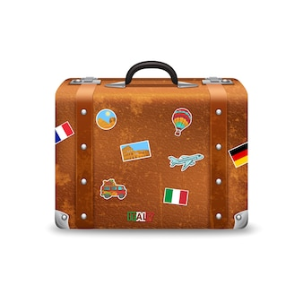 Old style voyage suitcase with travel stickers