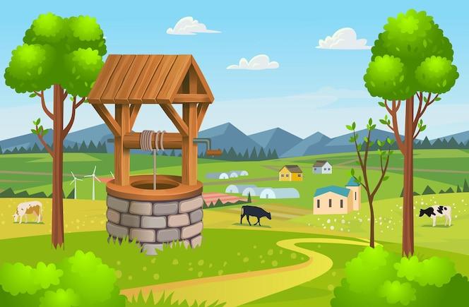 Vecchio pozzo in pietra del villaggio con tetto in legnovillaggio di sfondo con campi di serre