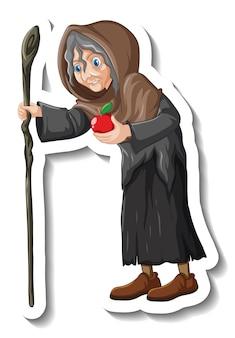 Vecchia strega che tiene in mano il bastone e l'adesivo del personaggio dei cartoni animati della mela