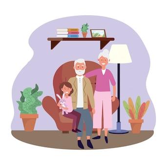 의자에 granddauhter와 늙은 여자와 남자
