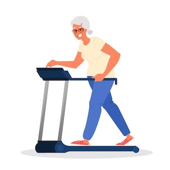 체육관에서 늙은 여자. 디딜 방아에 대한 수석 교육. 노인을위한 피트니스 프로그램. 건강한 라이프 스타일 개념.